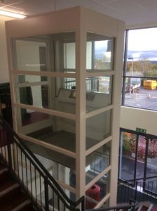 Extremely Compact Platform Lift Parallel to Stairs